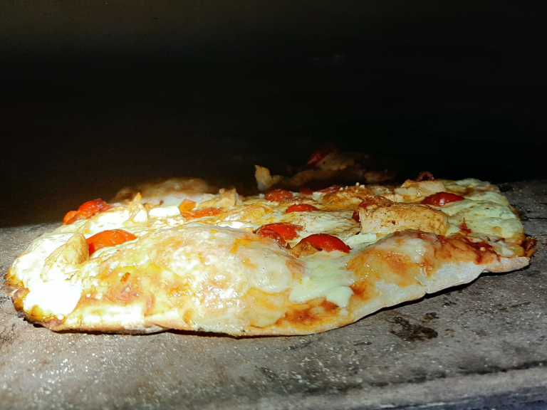 Sweet Chilli Chicken pizza in the pizza oven