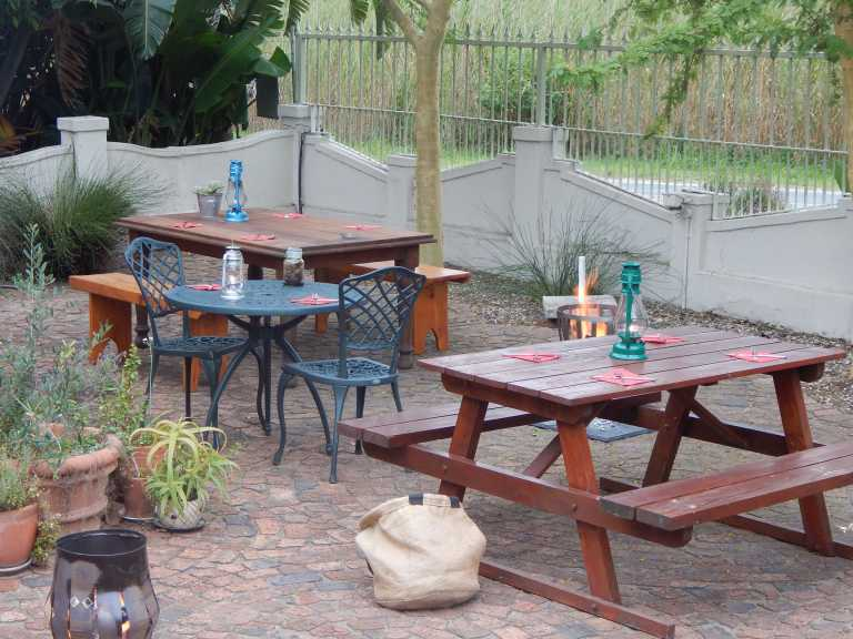 Our kitchen provides delicious meals - Tables in the garden for meals to be enjoyed outdoors