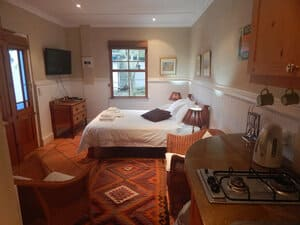 Self-catering accommodation in The Garden Room bedroom showing kitchenette