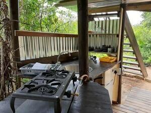 The Nest - camp kitchen beneath the deck